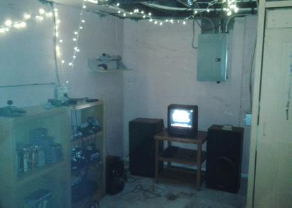 A small CRT TV and a variety of retro consoles.